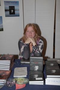 Med böckerna på Värmländsk bokmässa. Jag är egentligen ännu gladare än jag ser ut.
